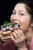 Woman chef offers a dish of smoked mackerel Royalty Free Stock Image