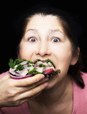 Woman chef offers a dish of smoked mackerel. On the dish with vegetables Stock Photos