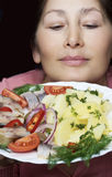 Woman chef offers a dish of smoked mackerel Stock Image
