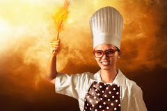 Woman Chef On Fire Stock Image