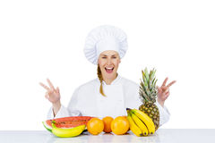 Woman chef over the table with fruits smiling. isoleted Stock Image