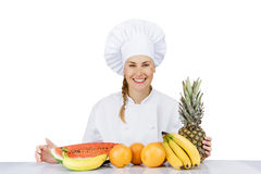 Woman chef over the table with fruits smiling. isoleted Stock Photos