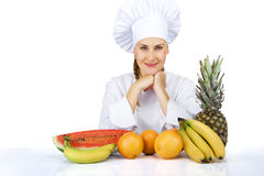 Woman chef over the table with fruits smiling. isoleted Royalty Free Stock Photography