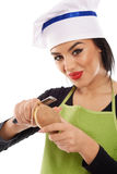Woman chef peeling potato Royalty Free Stock Image