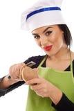 Woman chef peeling potato Royalty Free Stock Image