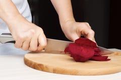 Woman chef prepare beets Stock Photo