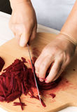 Woman chef prepare beets Royalty Free Stock Images