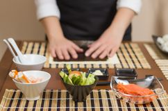 Woman chef ready to prepare japanese sushi rolls Stock Images