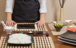 Woman chef ready to prepare japanese sushi rolls Royalty Free Stock Image