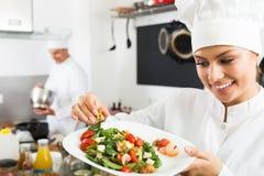Woman chef serving fresh salad Royalty Free Stock Photo