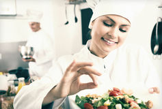 Woman chef serving fresh salad Royalty Free Stock Image