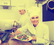 Woman chef serving fresh salad Stock Image
