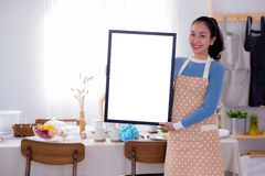 woman chef showing blank empty board menu. Stock Photos
