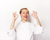 Woman chef showing sign perfect both hands over whita background Royalty Free Stock Photo