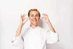 Woman chef showing sign perfect both hands over whita background Royalty Free Stock Photos