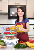 Woman chef showing thumb up Stock Photo