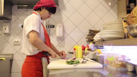 Woman chef sliced fresh vegetables and dill stock footage