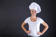 Woman chef smiling over dark background Royalty Free Stock Photo