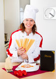 Woman chef with spaghetti Royalty Free Stock Photography