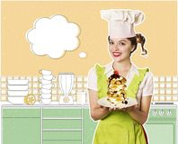Woman chef and sweet pancakes in the kitchen room Royalty Free Stock Photography