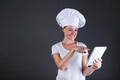 Woman chef with tablet over dark background Stock Image