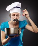 Woman chef tasting the soup Stock Photos