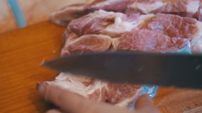 Woman Chef Throws Sliced Meat on a Cutting Board in the Home Kitchen stock video footage