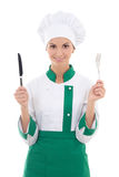Woman chef in uniform holding fork and knife isolated on white Royalty Free Stock Photos