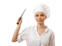 Woman Chef in uniform holding a kitchen knife Royalty Free Stock Photo