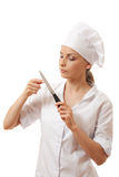 Woman Chef in uniform holding a kitchen knife Stock Photo