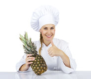 Woman chef in uniform. Isolated on white background with pineapp Royalty Free Stock Images