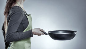 Woman chef with a wok Stock Photos