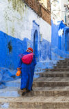 A woman at Chefchaouen, Morocco. Chefchaouen or Chaouen is a city in northwest Morocco. It is the chief town of the province of the same name, and is noted for royalty free stock photography