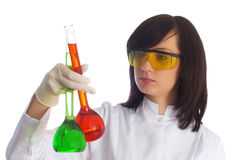 Woman with chemical tubes in the labatory on white. Woman with chemical  tubes in the labatory on white Royalty Free Stock Images