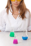 Woman chemist and chemicals in flasks Royalty Free Stock Images