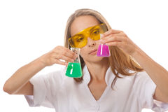 Woman chemist and chemicals in flasks Royalty Free Stock Photos