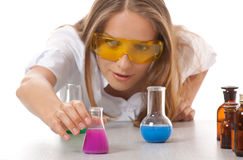 Woman chemist and chemicals in flasks Stock Photo