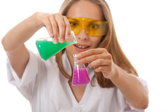 Woman chemist and chemicals in flasks Royalty Free Stock Image