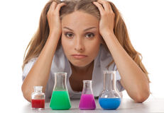 Woman chemist and chemicals in flasks Stock Photography