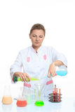 Woman chemist and chemicals in flasks, isolated on Royalty Free Stock Photo