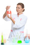 Woman chemist and chemicals in flasks, isolated on Royalty Free Stock Image
