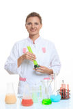 Woman chemist and chemicals in flasks, isolated on Stock Photography