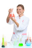 Woman chemist and chemicals in flasks, isolated on Stock Photo