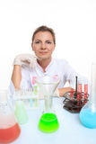 Woman chemist and chemicals in flasks, isolated on Stock Images