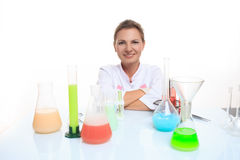 Woman chemist and chemicals in flasks, isolated on Royalty Free Stock Images
