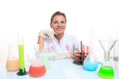 Woman chemist and chemicals in flasks, isolated on Royalty Free Stock Photos