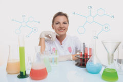 Woman chemist and chemicals in flasks, isolated on white Royalty Free Stock Photo