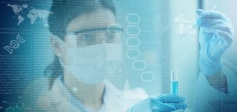 Woman chemist holding a test tube
