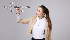 Woman chemist shows a molecular structure Royalty Free Stock Photos