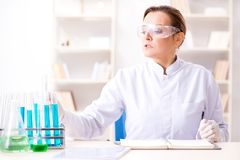The woman chemist working in hospital clinic lab. Woman chemist working in hospital clinic lab Royalty Free Stock Photos